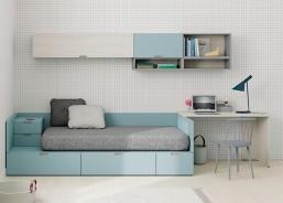 Dormitorio juvenil cama con cajones y zona independiente de escritorio y armariada, con posibilidad de estanterias para libros.