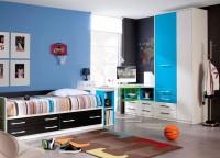 Dormitorio juvenil compuesto por cama compacta con 2 cajones y 1 contenedor largo; mesa de estudio de diseño libre con soporte de librería y 2 módulos de cajones y hueco y armario de puertas asimétricas con 4 cajones.