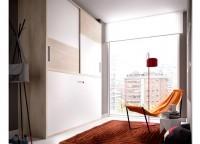 Dormitorio juvenil compuesto por 2 camas independientes con un cabezal corrido a pared de la medida que deseemos, mesita de 2 cajones de 52 cms. y 4 módulos diáfanos a pared de 33x33.