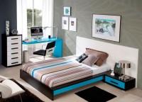 Dormitorio juvenil compuesto por cama panel con bañera plana para colchón de 135, mesa de estudio con un canto redondeado de 152 cms. y xifonier con patas de 6 cajones de 52 cms.