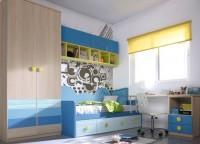 Habitación infantil con armario de 2 puertas acabadas con 5 paneles de diferentes tonos. Cama nido de 90 x 190 con 4 contenedores. La cama se ha rematado con un panel llamado