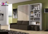 Salón con cama abatible vertical de matrimonio, para colchón de 150 x 190 con sofá integrado. El ambiente se completa con una librería asimétrica.