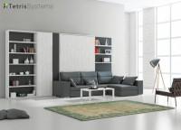Salón DIVO con librerías y cama abatible de 150 x 200 con sofá de asientos elevables y módulo chaise longue con arcón trasero.