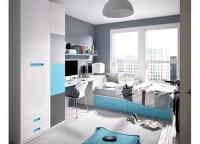 Habitación infantil con mesa de estudio rincón. Cama compacto con laterales y cama inferior oculta . Armario de puertas correderas.