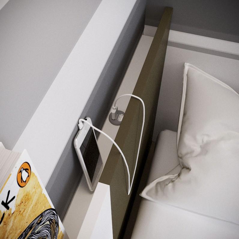 Detalle de cabezal con puertos USB para carga de dispositivos