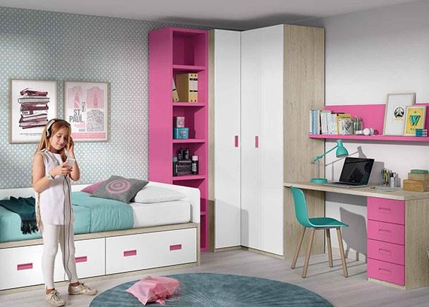Dormitorio infantil equipado con un compacto con base de dos cajones grandes. Entre la cama y el armario rincón, se ha colocado un módulo terminal c
