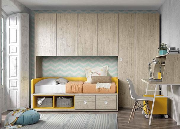 Habitación infantil equipada con una novedosa cama nido con dos grandes contenedores y dos huecos diáfanos en su base. El ambiente cuenta con un alt