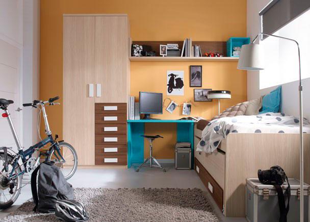 Dormitorio juvenil con cama compacta y nido oculto abatible con dos gavetas. Mesa de estudio con encimera recta de 104 cm en color turquesa soportada