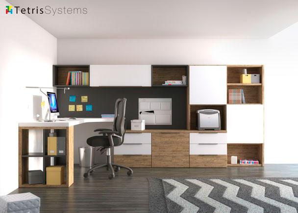 Despacho de uso individual con estantería mural apoyada sobre una credencia de cajones y archivadores y escritorio de sobre angular.