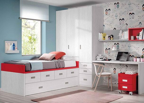 Dormitorio infantil con compacto nido de 4 cajones con somier de arrastre. En la cabecera de la cama se sitúa la zona de armarios, compuesta por un a