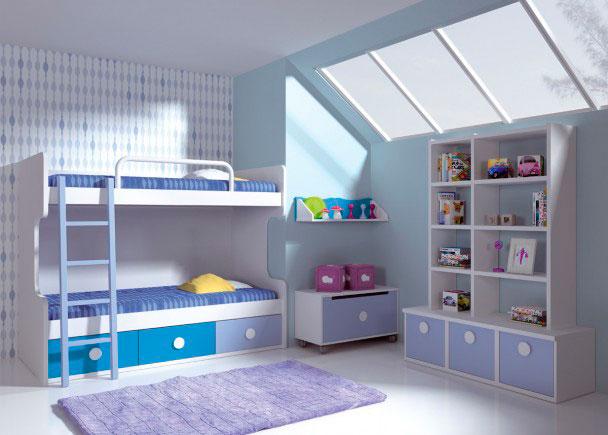Habitación infantil con litera de 2 camas, que cuenta con una práctica base nido con 3 cajones contenedores de gran capacidad.Ambas cama