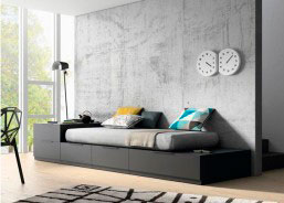 Salón con cama con cajones y escritorio integrado totalmente modular.El precio valorado es de la estructura de cama con todos los cajones