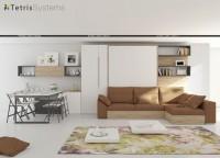 Salón con mesa y cama abatible con sofá DIVO y armario terminal, armario, estantes y librería.