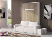 Salón con cama abatible vertical de matrimonio, para colchón de 150 x 190 con sofá integrado. El ambiente se puede completar con otros elementos, como módulos bajos, colgantes, escritorios y librerías.
