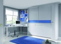 Zonas de estudio: Habitación con cama abatible, armario corredero superior, armario terminal curvo y Mesa de estudio en L con patas blancas.